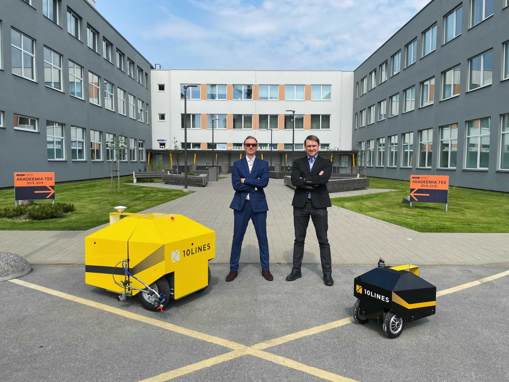 The masterminds of 10Lines, Tarmo Prints and Jano Paas together with their autonomous robots.
