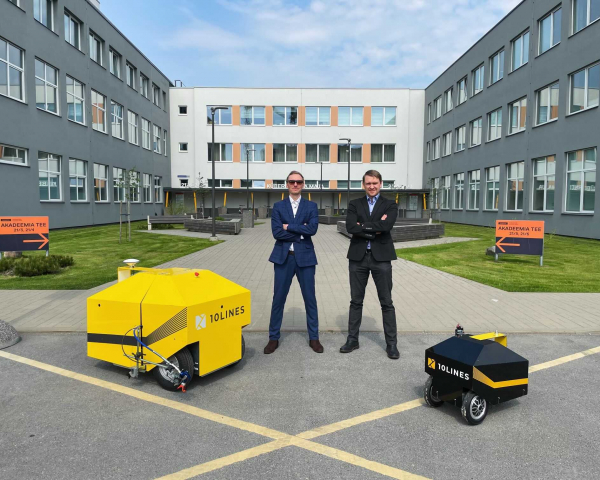 The masterminds of 10Lines, Tarmo Prints and Janno Paas together with their autonomous robots.
