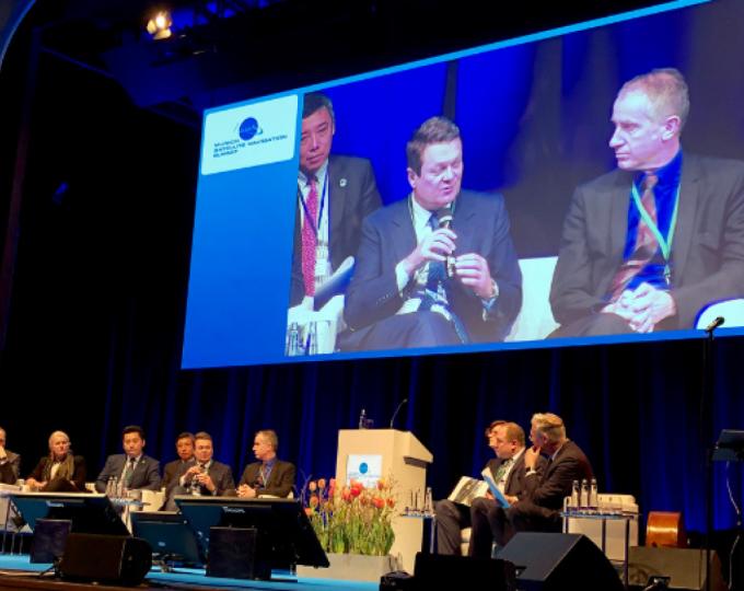 Panel members (l-r) Mattias Petschke, Jan Woerner, Pascale Ehrenfreund, Jia Peng, Carlo des Dorides, David Comby and Oleg Kem, with moderator Claus Kruesken at the opening plenary.